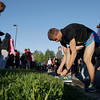 Record-Eagle/Keith King<br /> Jesse Anderson, of Fenton, ties his shoes as he prepares Saturday, May 25, 2013 for the start of the 31st annual Bayshore Marathon.