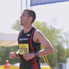 Record-Eagle/Keith King<br /> Jonathan Gries finishes first in the men's marathon Saturday, May 25, 2013 during the 31st annual Bayshore Marathon.