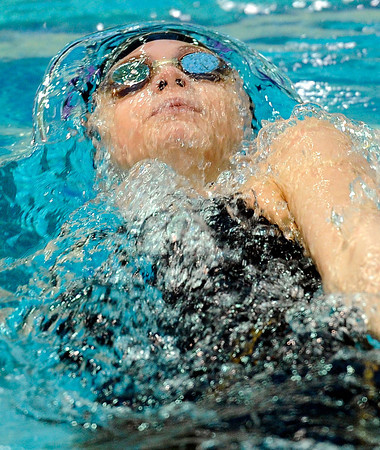 """Boulder High School's Haley Rowley emerges from underwater while swimming in the 100-yard backstroke during the Boulder County Invitational swim meet at the Veterans Memorial Aquatic Center in Thornton. Rowley took 1st place. For more photos of the meet go to  <a href=""""http://www.dailycamera.com"""">http://www.dailycamera.com</a><br /> Jeremy Papasso/ Camera"""