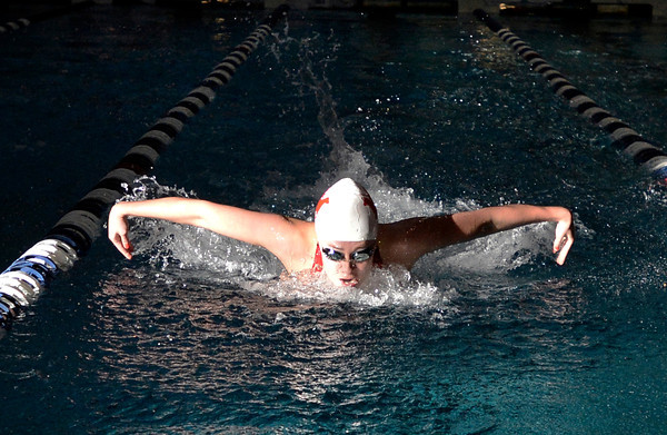 """Fairview High School's Julia Box swims the 100-yard butterfly during the Boulder County Invitational swim meet at the Veterans Memorial Aquatic Center in Thornton. For more photos of the meet go to  <a href=""""http://www.dailycamera.com"""">http://www.dailycamera.com</a><br /> Jeremy Papasso/ Camera"""