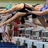 """Niwot High School's Hannah Driscoll dives into the pool during the 200-yard freestyle relay during the Boulder County Invitational swim meet at the Veterans Memorial Aquatic Center in Thornton. For more photos of the meet go to  <a href=""""http://www.dailycamera.com"""">http://www.dailycamera.com</a><br /> Jeremy Papasso/ Camera"""