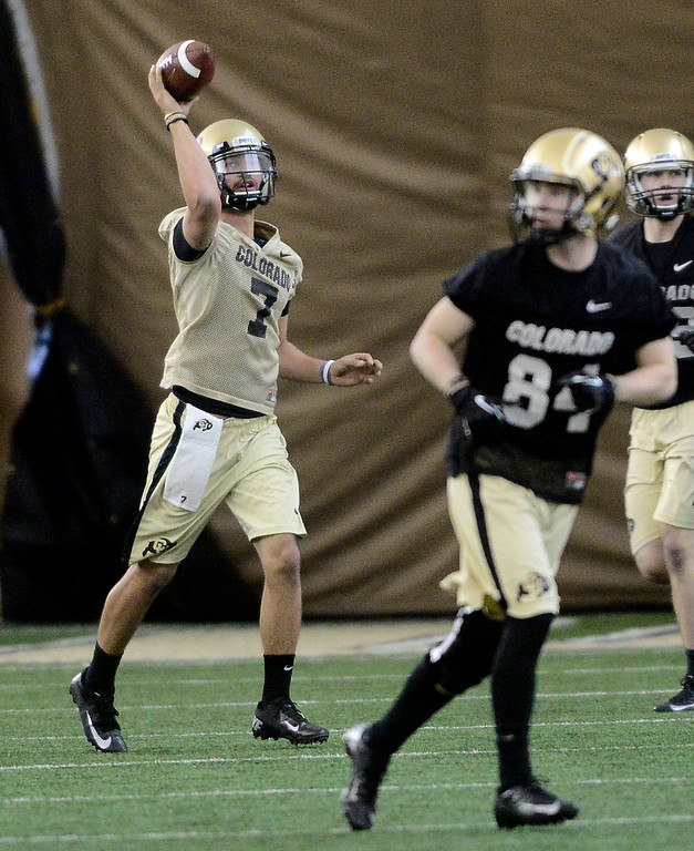 . University of Colorado\'s Jordan Gehrke (7) tosses the football in the practice bubble on CU\'s Boulder campus on Friday during the football team\'s first spring practice. March 7, 2014. For more photos go to www.buffzone.com. Photo by Paul Aiken / The Boulder Daily Camera