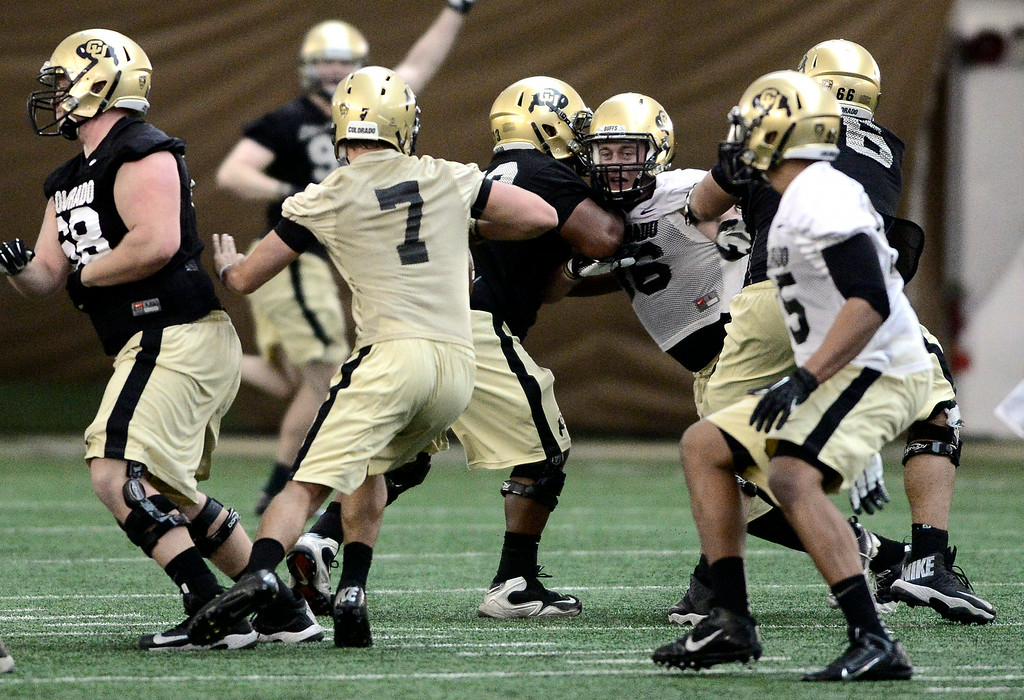 . University of Colorado\'s Jordan Gehrke (7) tries to find a hole in the defense in the practice bubble on CU\'s Boulder campus on Friday during the football team\'s first spring practice. March 7, 2014. For more photos go to www.buffzone.com. Photo by Paul Aiken / The Boulder Daily Camera