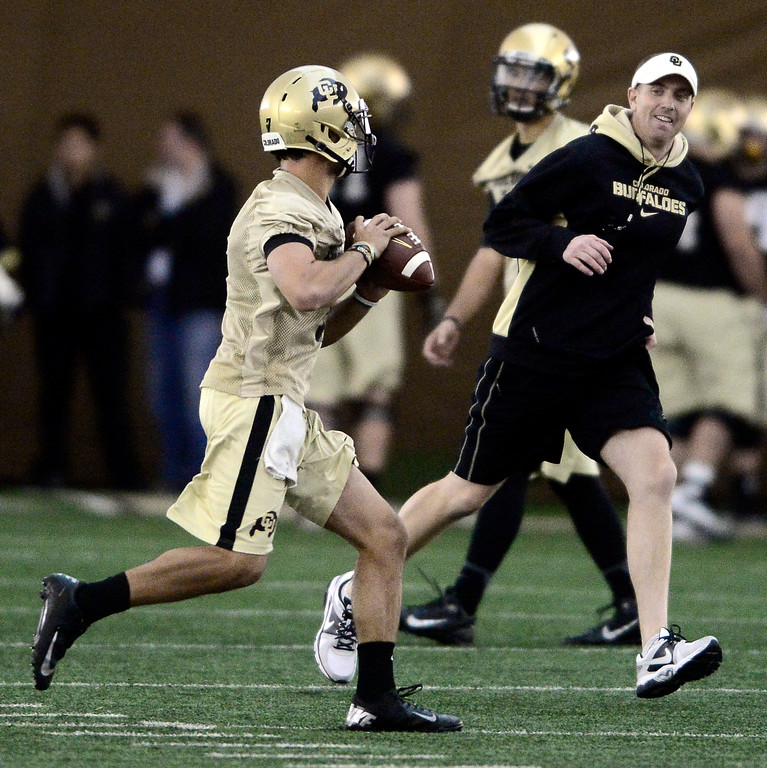 . University of Colorado\'s quarterback Jordan Gehrke (7) rolls out of the pocket during a drill in the practice bubble on CU\'s Boulder campus on Friday during the football team\'s first spring practice. March 7, 2014. For more photos go to www.buffzone.com. Photo by Paul Aiken / The Boulder Daily Camera