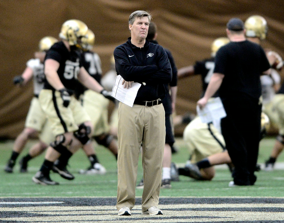 . University of Colorado\'s Head football coach Mike MacIntyre doesn\'t like what he sees in the practice bubble on CU\'s Boulder campus on Friday during the football team\'s first spring practice. March 7, 2014. For more photos go to www.buffzone.com. Photo by Paul Aiken / The Boulder Daily Camera