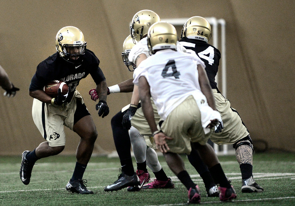 . University of Colorado\'s tailback Malcolm Creer (10) runs towards the defense in the practice bubble on CU\'s Boulder campus on Friday during the football team\'s first spring practice. March 7, 2014. For more photos go to www.buffzone.com. Photo by Paul Aiken / The Boulder Daily Camera