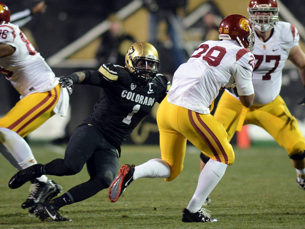. Derrick Webb of CU tries to run down Ty Isaac  of USC during the first half of the November 23, 2013 game in Boulder, Colorado.  Cliff Grassmick / November 23, 2013