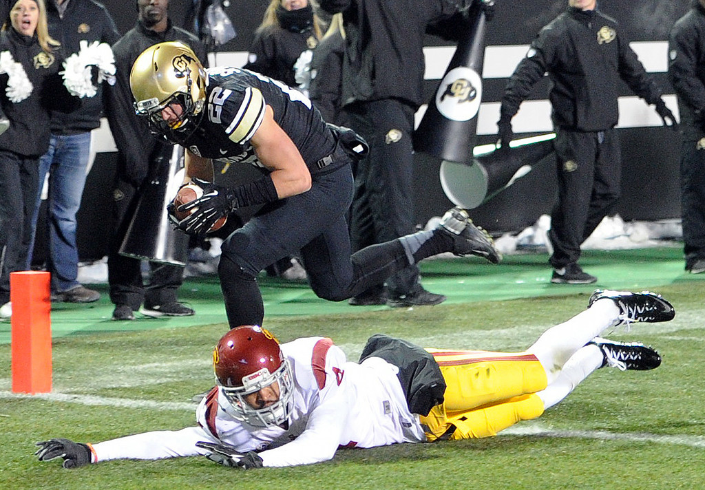 . Nelson Spruce of CU makes a circus catch to score a touchdown on Torin Harris of USC during the second half of the November 23, 2013 game in Boulder, Colorado.  Cliff Grassmick / November 23, 2013