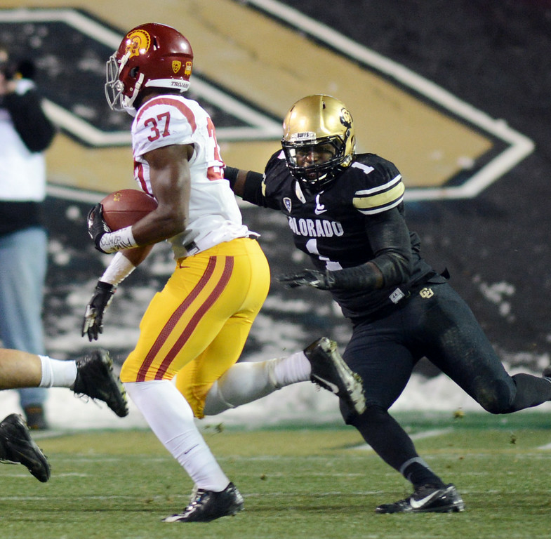 . Derrick Webb of CU tries to run down Javorius Allen of USC during the first half of the November 23, 2013 game in Boulder, Colorado.  Cliff Grassmick / November 23, 2013