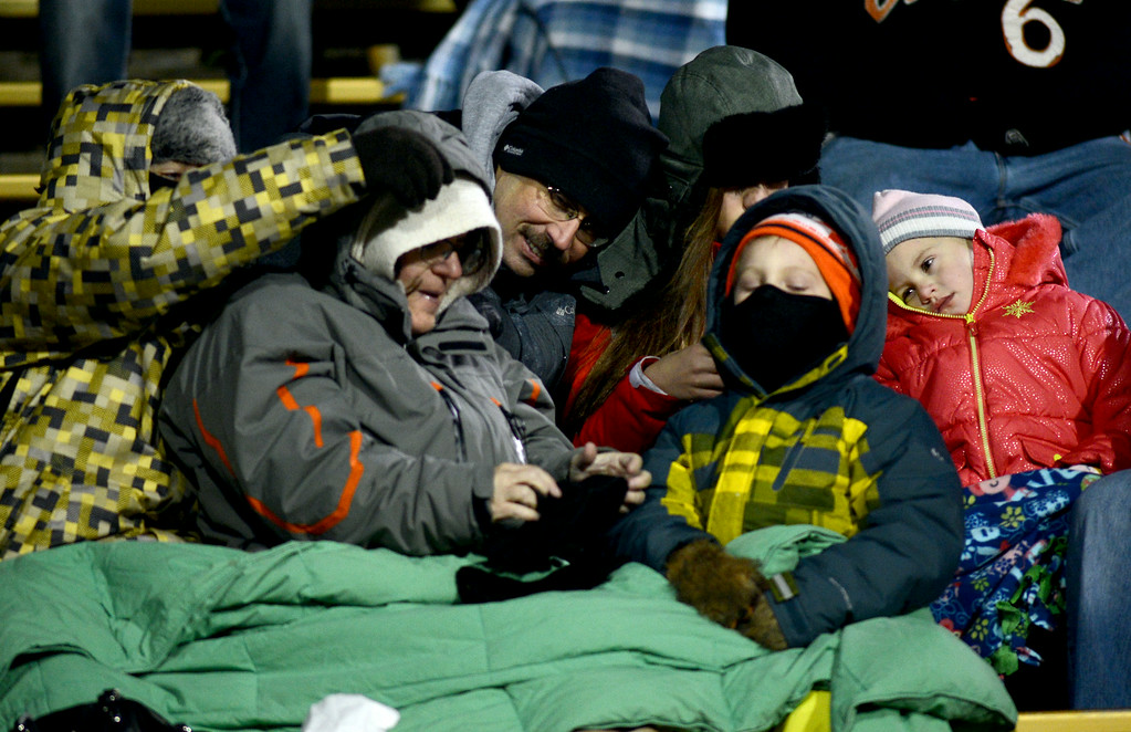 . Folsom Field fans try to stay warm during the first half of the November 23, 2013 game in Boulder, Colorado.  Cliff Grassmick / November 23, 2013