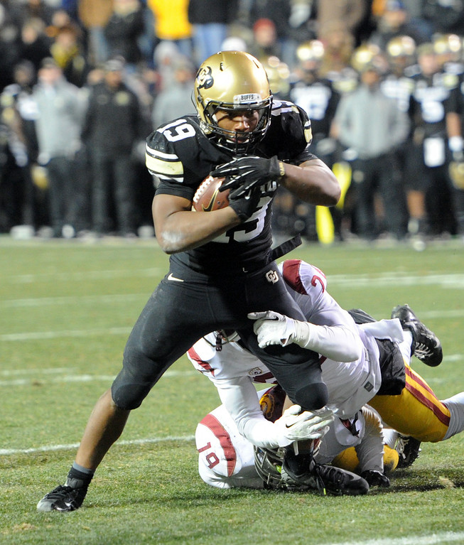 . Michael Akins II of CU scores a touchdown on a short run during the second half of the November 23, 2013 game in Boulder, Colorado.  Cliff Grassmick / November 23, 2013