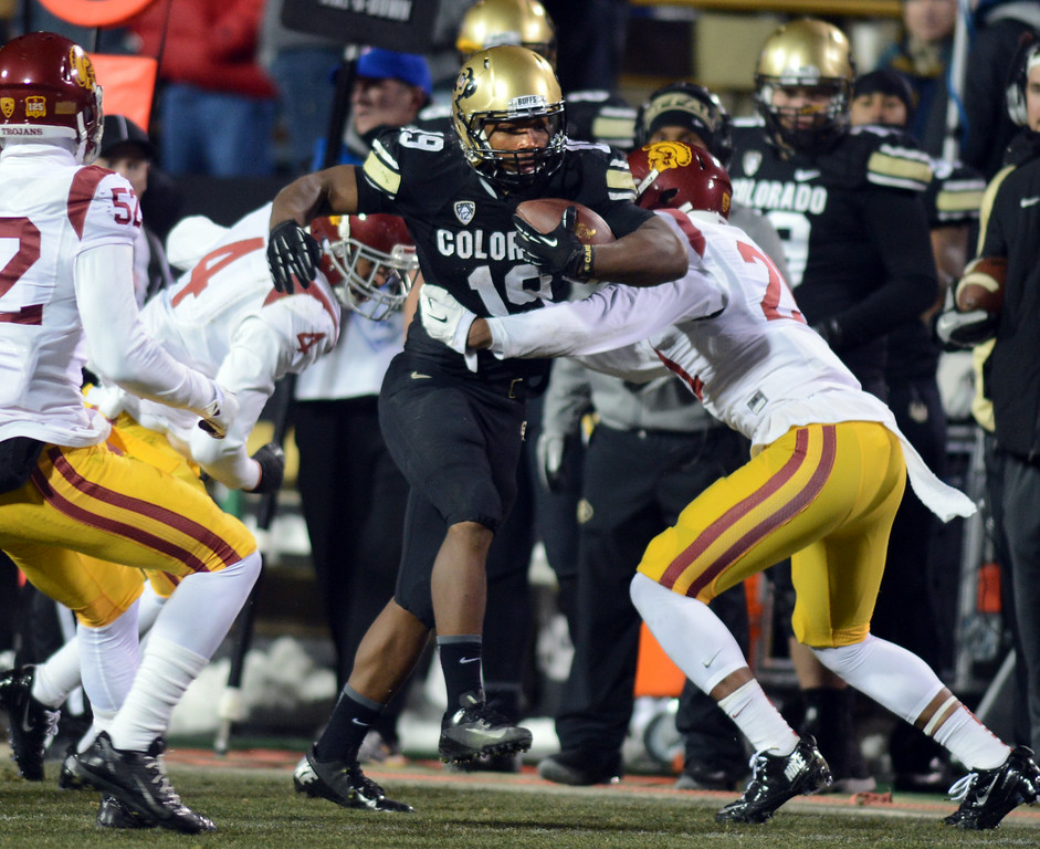 . Michael Adkins of CU makes yards against USC during the second half of the November 23, 2013 game in Boulder, Colorado.  Cliff Grassmick / November 23, 2013