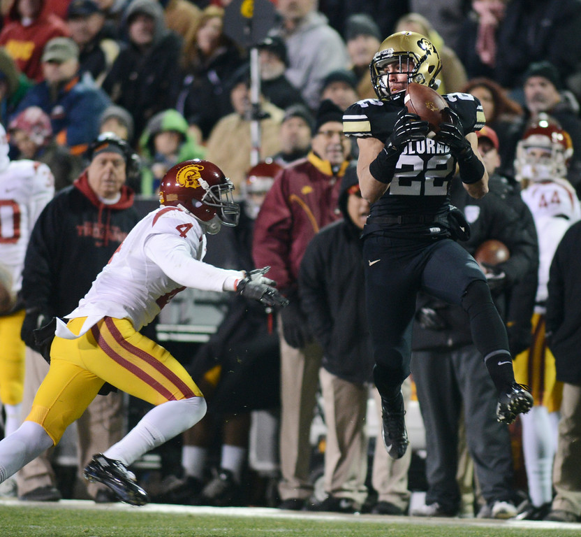 . Nelson Spruce of CU drops this ball with Torin Harris of USC defending, during the first half of the November 23, 2013 game in Boulder, Colorado.  Cliff Grassmick / November 23, 2013