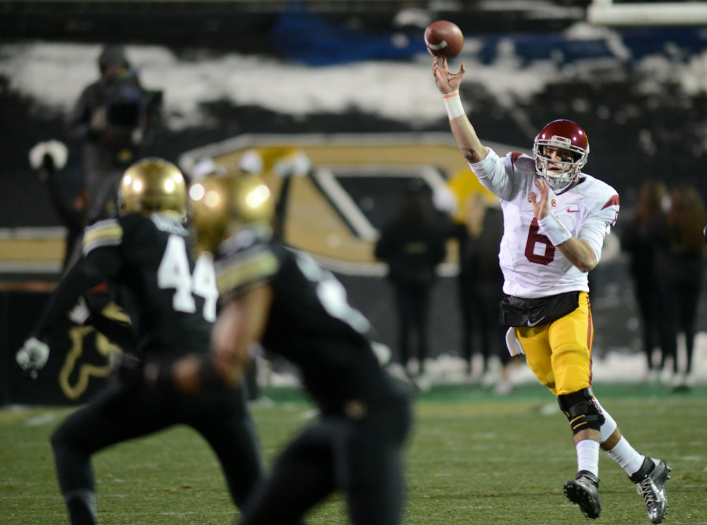 . Cody Kessler of USC  throws a long pass during the first half of the November 23, 2013 game in Boulder, Colorado.  Cliff Grassmick / November 23, 2013