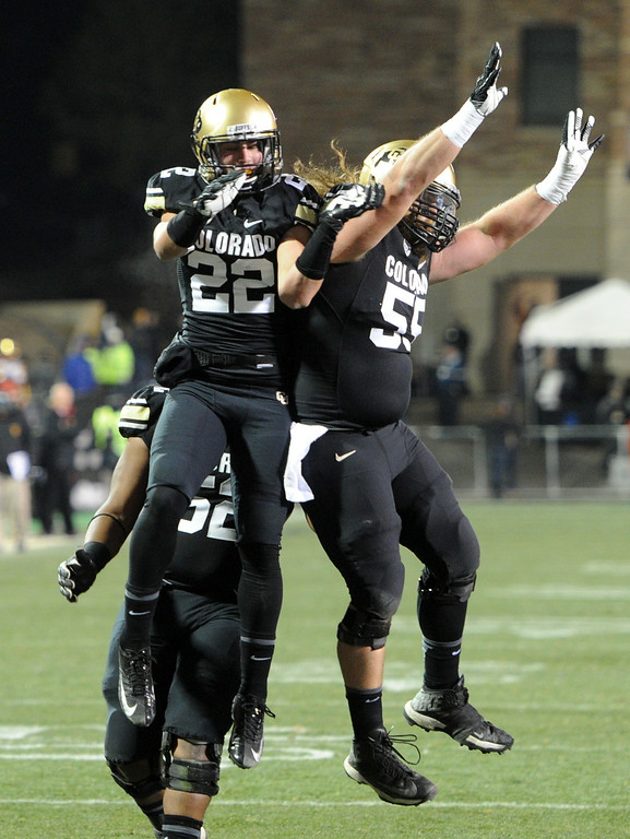 . Nelson Spruce of CU celebrates his TD catch with Gus Handler during the second half of the November 23, 2013 game in Boulder, Colorado.  Cliff Grassmick / November 23, 2013