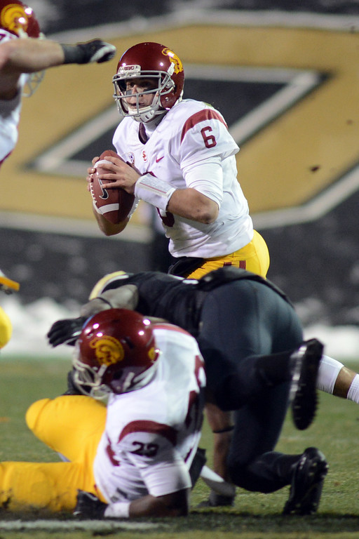 . Cody Kessler of USC looks for receivers during the first half of the November 23, 2013 game in Boulder, Colorado.  Cliff Grassmick / November 23, 2013