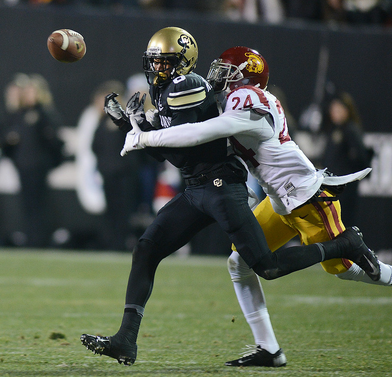 . Demetrius Wright, of USC, breaks up this pass for Paul Richardson of CU during the first half of the November 23, 2013 game in Boulder, Colorado.  Cliff Grassmick / November 23, 2013