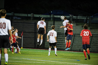 Varsity soccer between Pittsfield (red) and Derryfield (white) held on September 13, 2013 at the The Derryfield School in Manchester, NH.