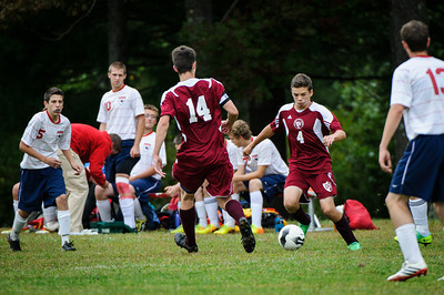 Varsity soccer between Pittsfield (white) and Derryfield (maroon) held on September 25, 2013 at the Drake Field in Pittsfield, NH.
