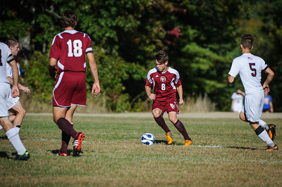 Varsity soccer between Wilton-Lyndeborough (white) and Derryfield (maroon) held on September 30, 2013 at the Wilton-Lyndeborough High School in Wilton, NH.