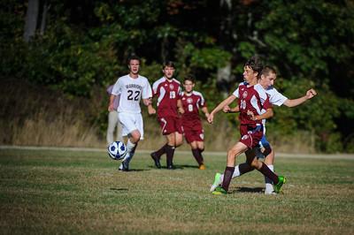 Varsity soccer between Wilton-Lyndeborough (white) and Derryfield (maroon) held on September 30, 2013 at the Wilton-Lyndeborough High School in Wilton, NH.
