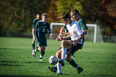 Varsity soccer between Sunapee (green) and Derryfield (white) held on October 9, 2013 at the The Derryfield School in Manchester, NH.