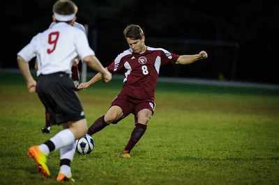 Varsity soccer between Newmarket (white) and Derryfield (maroon) held on October 11, 2013 at the Newmarket High School in Newmarket, NH.
