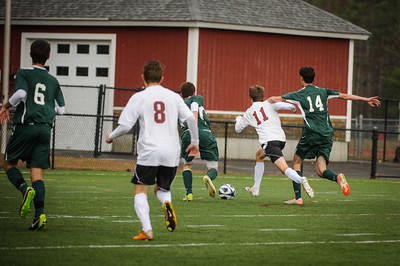 Jack fights his way through to score!  Varsity soccer state championship final between Sunapee (green) and Derryfield (white) held on November 10, 2013 at the Exeter High School in Exeter, NH.