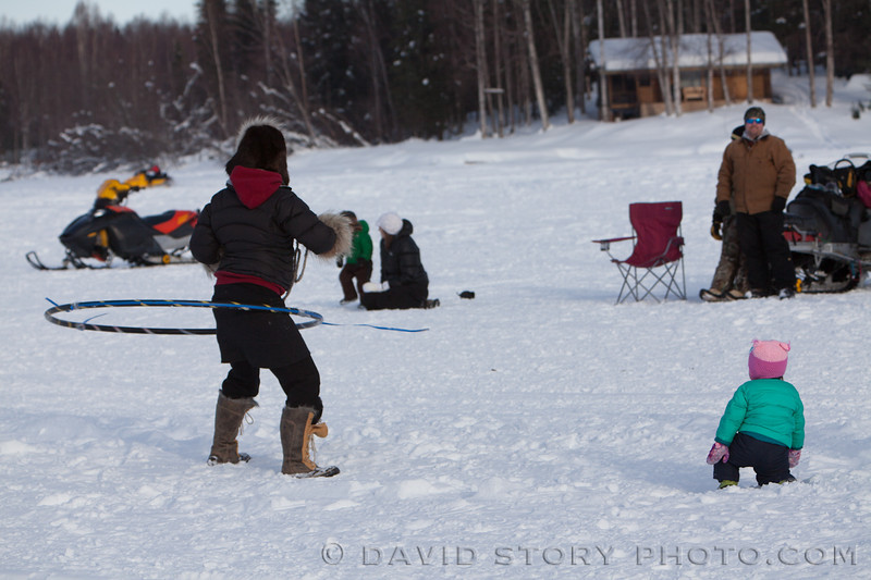 Hula hooping for racers at the 2013 Iditarod.