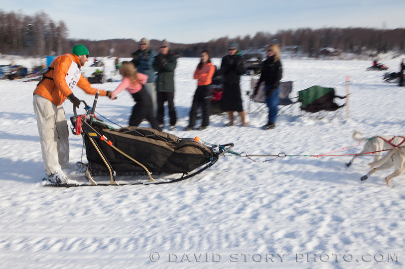 Kelly Maixner slips some skin as he sled by.