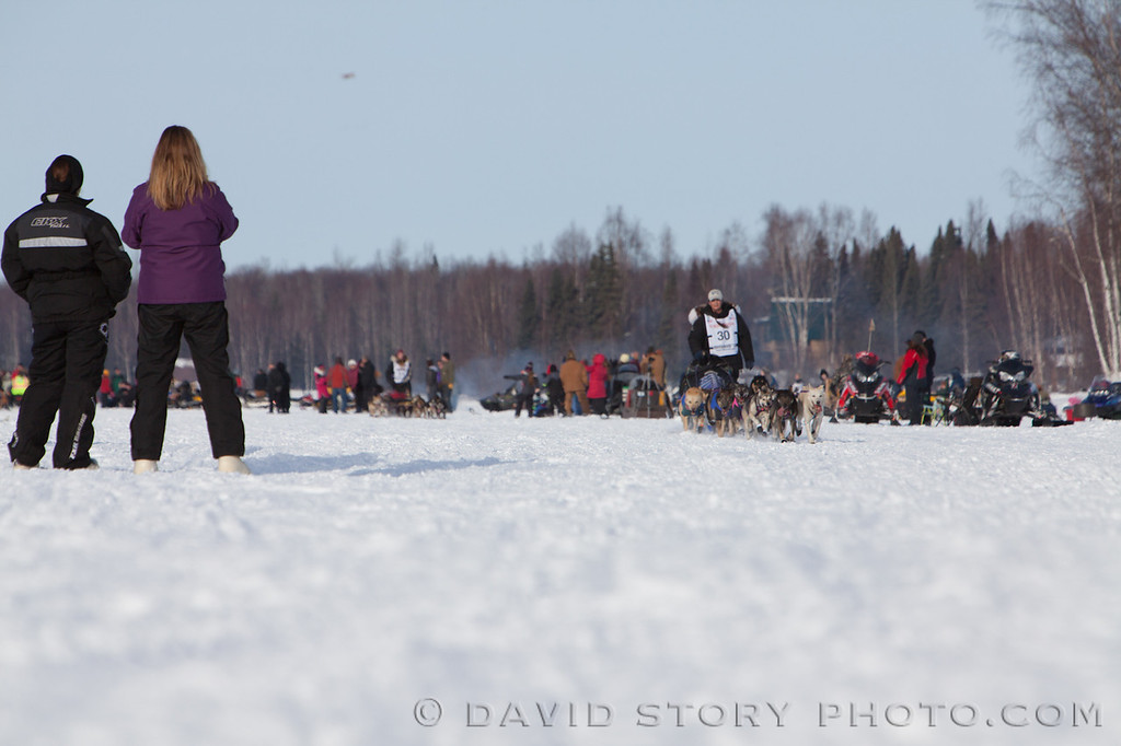Spectators look on as Jessie Royer approaches the end of Long Lake.