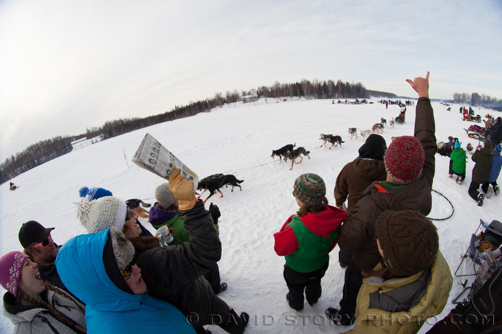 Fans cheer on racers along Long Lake at the 2013 Iditarod.