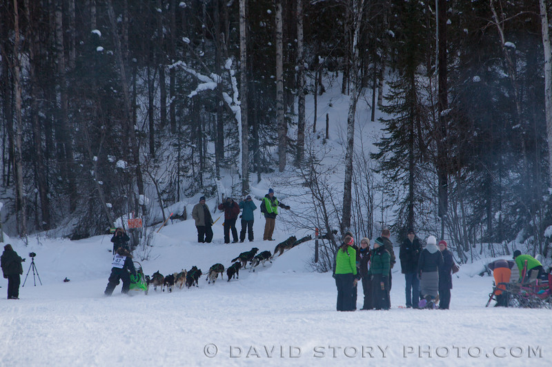 Luan Ramos Marques turns his dogs up the hill off of Long Lake.