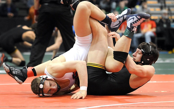 Sibley East's Hunter Retzlaff (in black) and United South Central's Derek Herman tangle during their State Class A 138 pound quarterfinal match Friday at the Xcel Energy Center in St. Paul.
