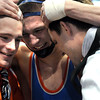 Madelia-Truman/Martin Luther's Adam Cooling hugs his coaches after winning the State Class A 160 pound championship Saturday at the Xcel Energy Center in St. Paul.