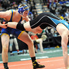 Le Sueur-Henderson's Chris Pfarr lifts Atwater-Cosmos-Grove City's Lee Whitcomb during their State Class A 152 pound quarterfinal match Friday at the Xcel Energy Center in St. Paul. Pfarr won the match 12-1.