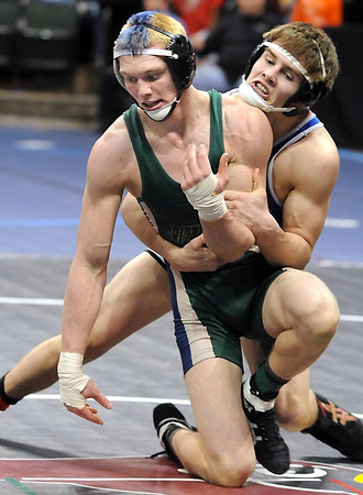 Waterville-Elysian-Morristown/Janesville-Waldorf-Pemberton's Brady Ayers works to get out of the hold of Thief River Falls/Goodridge's Holden Nelson during their 160 pound State Class AA quarterfinal match Friday at the Xcel Energy Center in St. Paul.