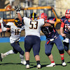 CARL RUSSO/Staff photo. Central Catholic's quarterback, Mike Milano, right, makes the pass. He had two touchdown passes and ran for a touchdown in Thursday game. Central defeated Andover 44-18 in the Thanksgiving Day game. 11/28/2013.