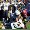 CARL RUSSO/Staff photo. Central Catholic's Edmunds Markus is unable to break away as Andover's Cole Organisciak (16) and Will Eikenberry double team to make the tackle. Central defeated Andover 44-18 in the annual Thanksgiving Day game. 11/28/2013.