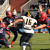 CARL RUSSO/Staff photo. Central Catholic's Paul Karamourtopoulos kicks the extra point after Central scored their first touchdown. Central defeated Andover 44-18 in the annual Thanksgiving Day game. 11/28/2013.