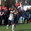 CARL RUSSO/Staff photo. Central Catholic's Gavin Anderson intercepts this pass in the first half. Central defeated Andover 44-18 in the Thanksgiving Day game. 11/28/2013.