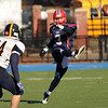 CARL RUSSO/Staff photo. Central Catholic's Jonathan Parsons kicks off to Andover after Central scored their first touchdown. Central defeated Andover 44-18 in the annual Thanksgiving Day game. 11/28/2013.