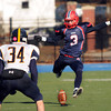 CARL RUSSO/Staff photo. Central Catholic's Jonathan Parsons leaps into the air as he kicks off to Andover after Central scored their first touchdown.  Central defeated Andover 44-18 in the annual Thanksgiving Day game. 11/28/2013.