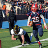 CARL RUSSO/Staff photo. Andover's Brian Duffy is unable to stop Central Catholic's captain, Cody Demers as he sprints down the sideline to score Central's first touchdown of the game. Central defeated Andover 44-18 in the Thanksgiving Day game. 11/28/2013.