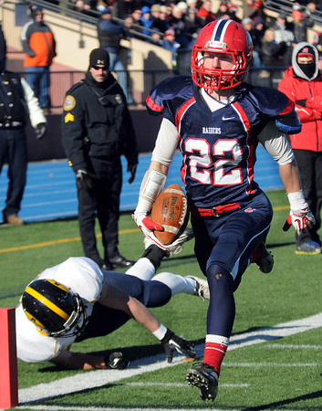 CARL RUSSO/Staff photo. Andover's Brian Duffy is unable to stop Central Catholic's captain, Cody Demers as he sprints down the sideline to score Central's first touchdown of the game. Central defeated Andover 44-18 in the annual Thanksgiving Day game. 11/28/2013.