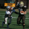 RYAN HUTTON/ Staff photo. Haverhill's Sammy Al-Ziab (39) pushes past Lowell's Keagan Latta (9) during the Thanksgiving Day game at Haverhill's Trinity Stadium.