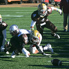 RYAN HUTTON/ Staff photo.  Haverhill's Tommy Maguire (4) and Josh Dion (26) scramble to recover a Lowell fumble and retake possession with 2:06 left to go in the third quarter of  the Thanksgiving Day game at Haverhill's Trinity Stadium.