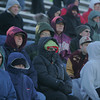 RYAN HUTTON/ Staff photo.  Lowell and Haverhill fans bundle up against the cold during the Thanksgiving Day game at Haverhill's Trinity Stadium.