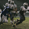 RYAN HUTTON/ Staff photo. Lawrence's Kenny Richards (44) tries to evade Salem's Joey Ward (79) during the second quarter of Wednesday night's game in Salem, NH.