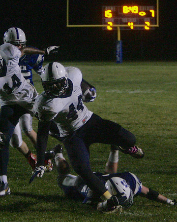 RYAN HUTTON/ Staff photo. Lawrence's Kenny Richards (44) is brought down by a Salem defender during the second quarter of Wednesday night's game in Salem, NH.